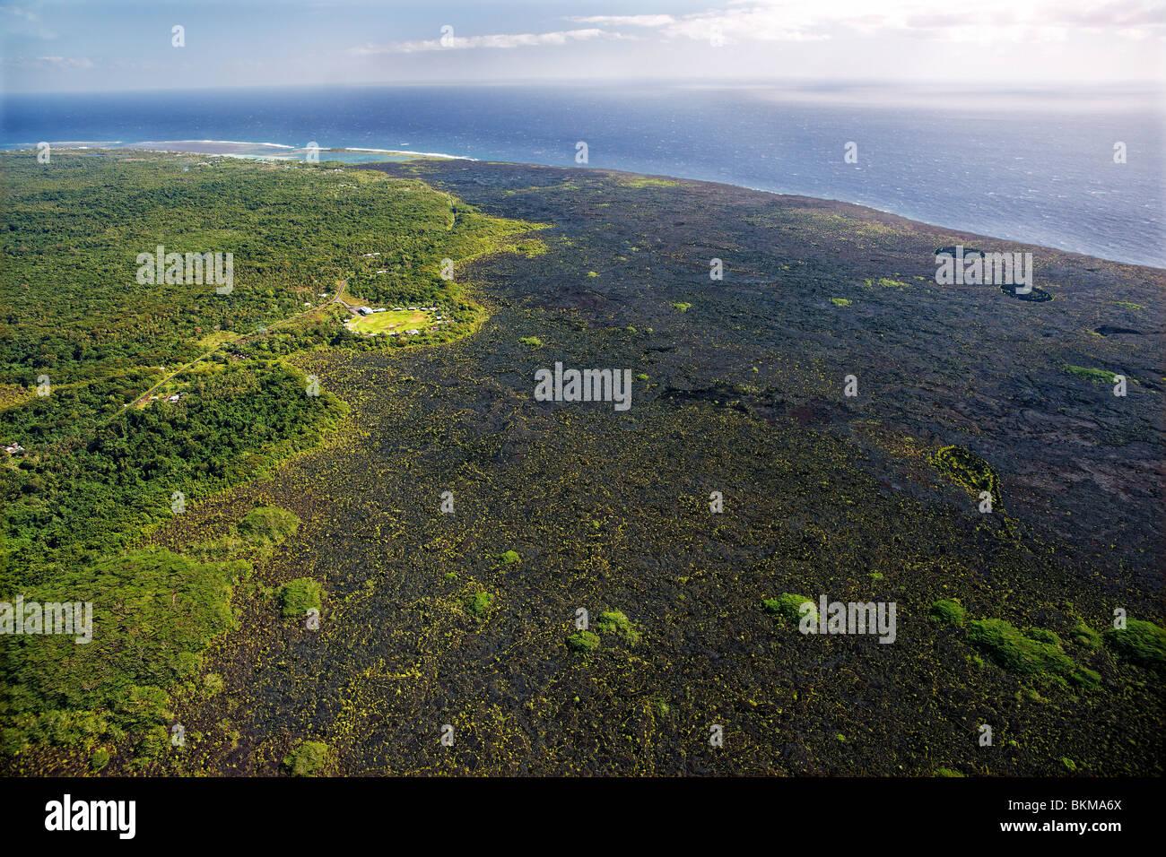 Aerial view of Mauga village and lava flow, Savaii, Samoa - Stock Image