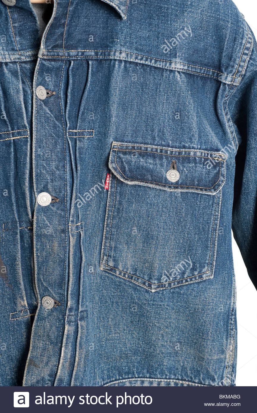 Close up details of a second pattern Levis Big E Buckle back pleated front jacket from 1947. These rare jackets - Stock Image