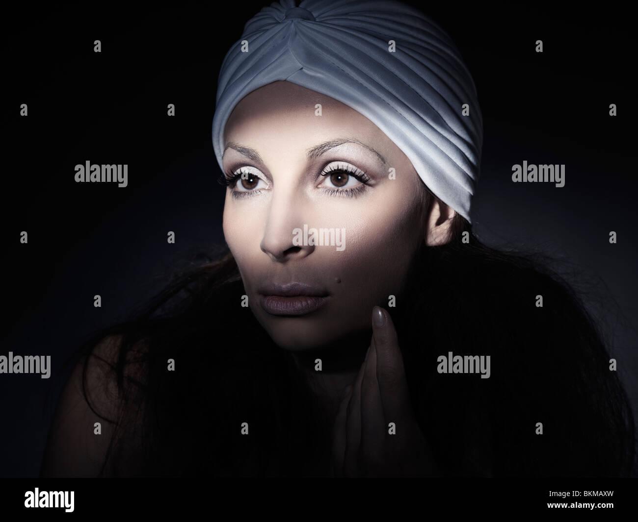 Light falling on a beautiful woman face artistic portrait - Stock Image