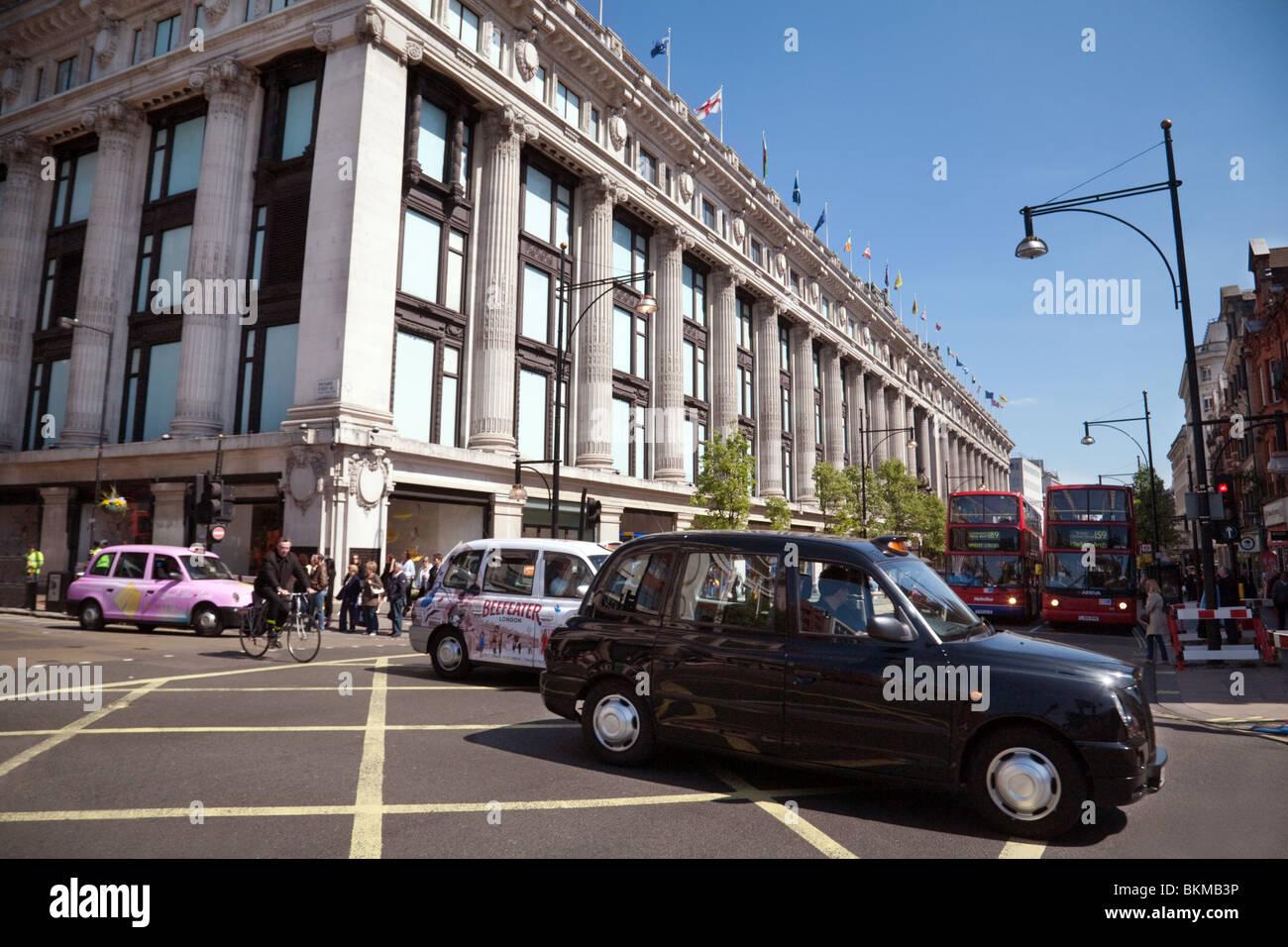 London Taxis outside the Selfridges store, Oxford Street, London UK - Stock Image