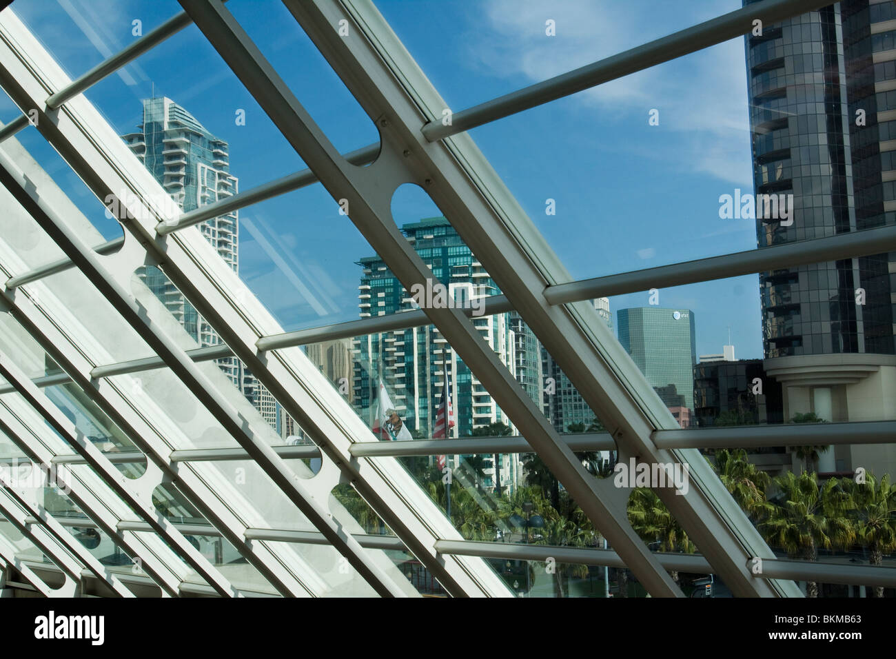 Buildings in downtown San Diego as seen through slanted glass wall in San Diego Convention Center - Stock Image