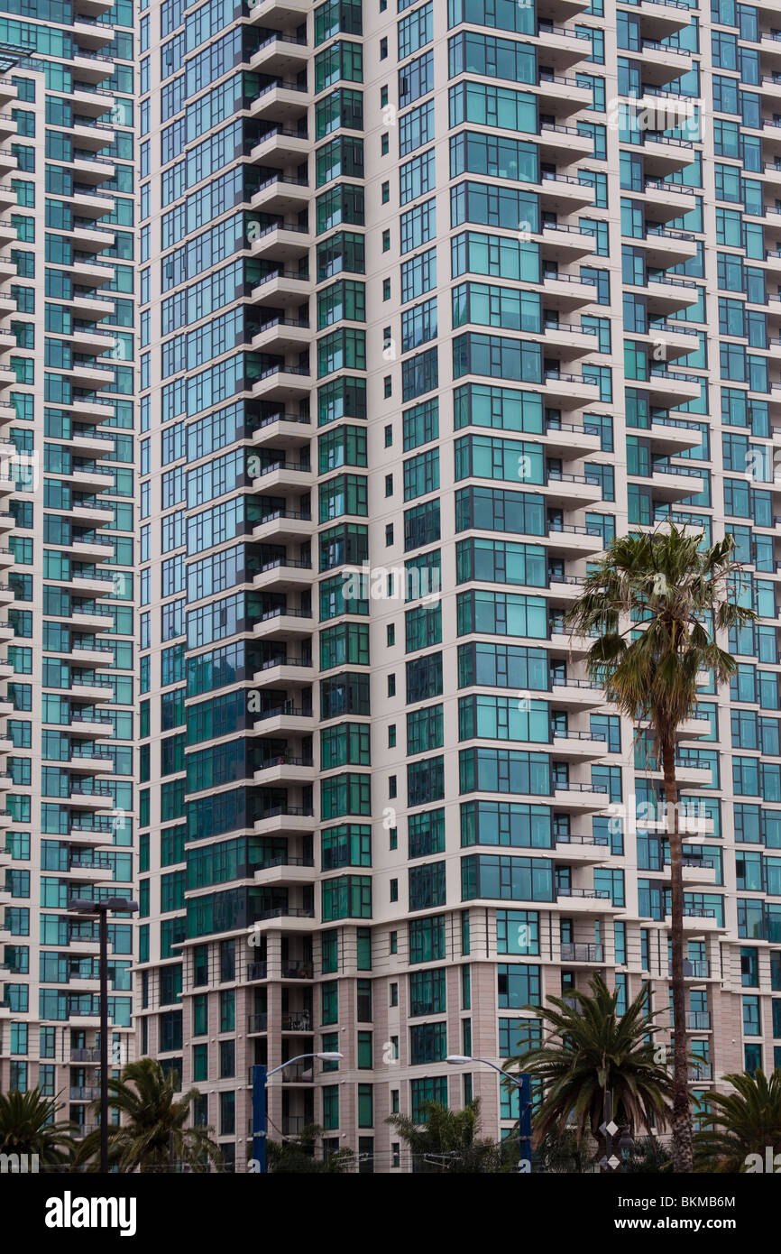 Windows and balconies of tall modern residential building in San Diego - Stock Image