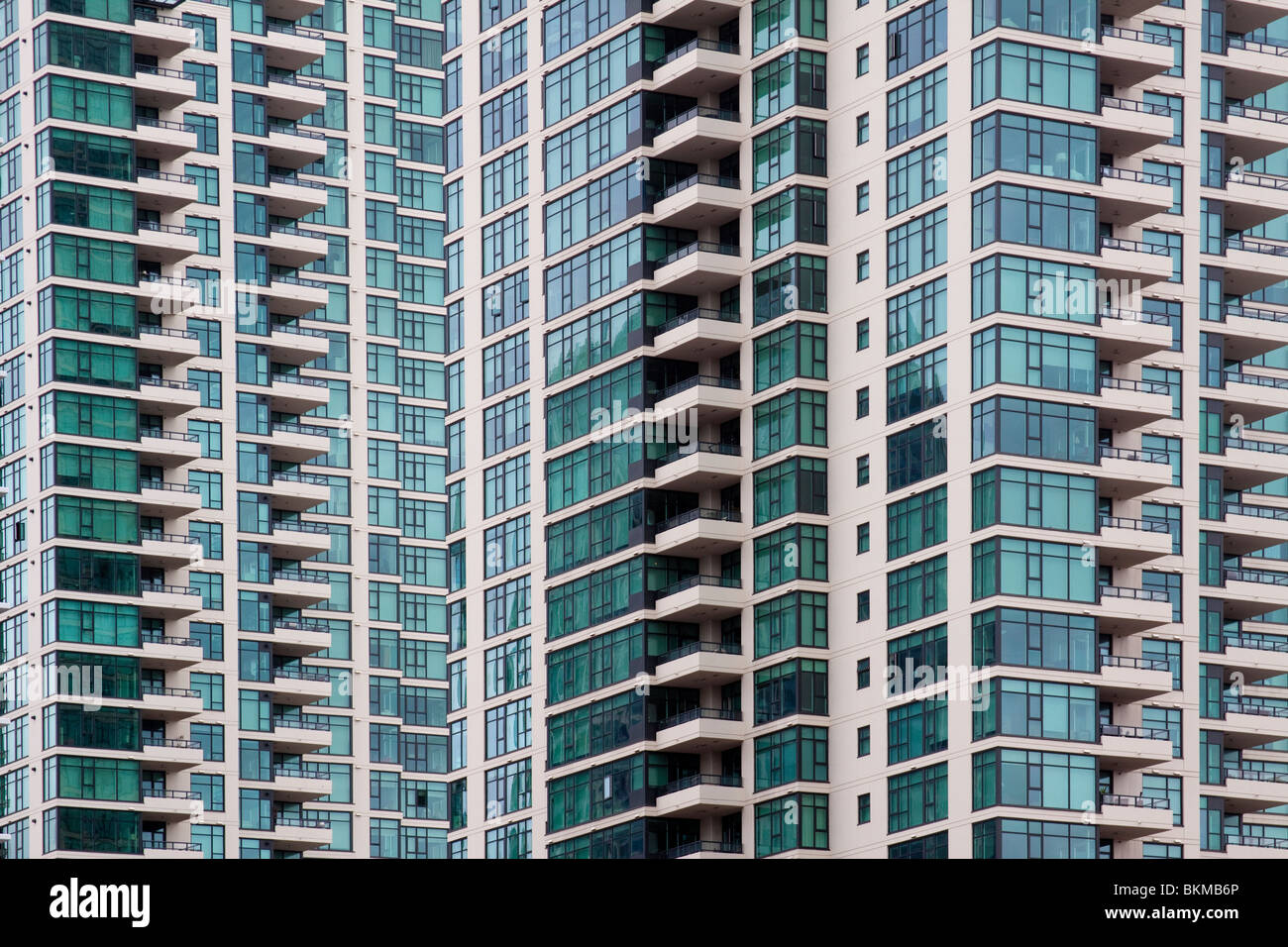Many windows and balconies of modern high rise building in San Diego, California - Stock Image