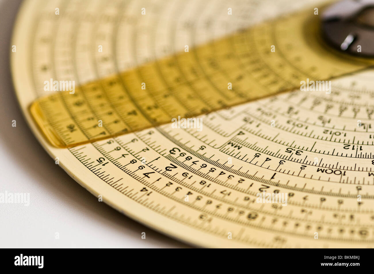 Concentric Binary Measuring Slide Ruler on white background. - Stock Image
