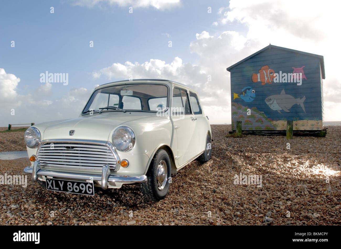 A White Austin Mini Cooper Mk2 Car Parked On A Pebble Beach On The
