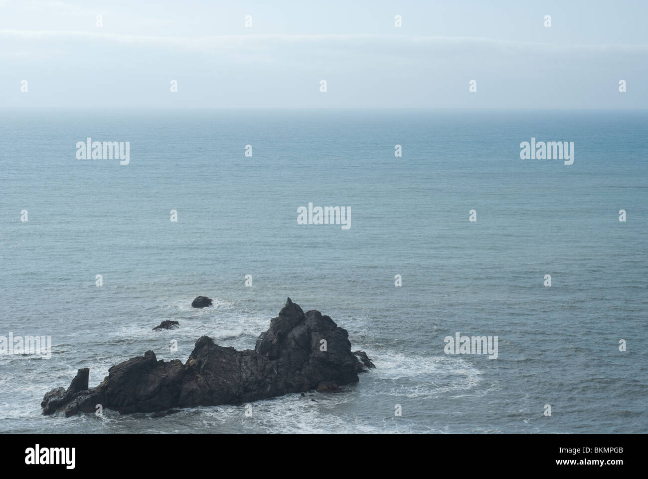 Rock Island off the Pacific Coast in northern California during an overcast morning - Stock Image
