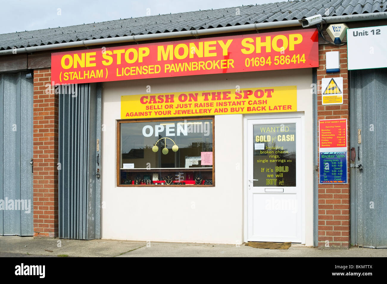 Modern Pawn Shop in Lock-up Unit - Stock Image