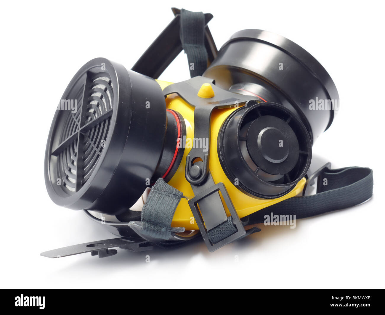 Respirator with interchangeable filter cartridges shot over white - Stock Image