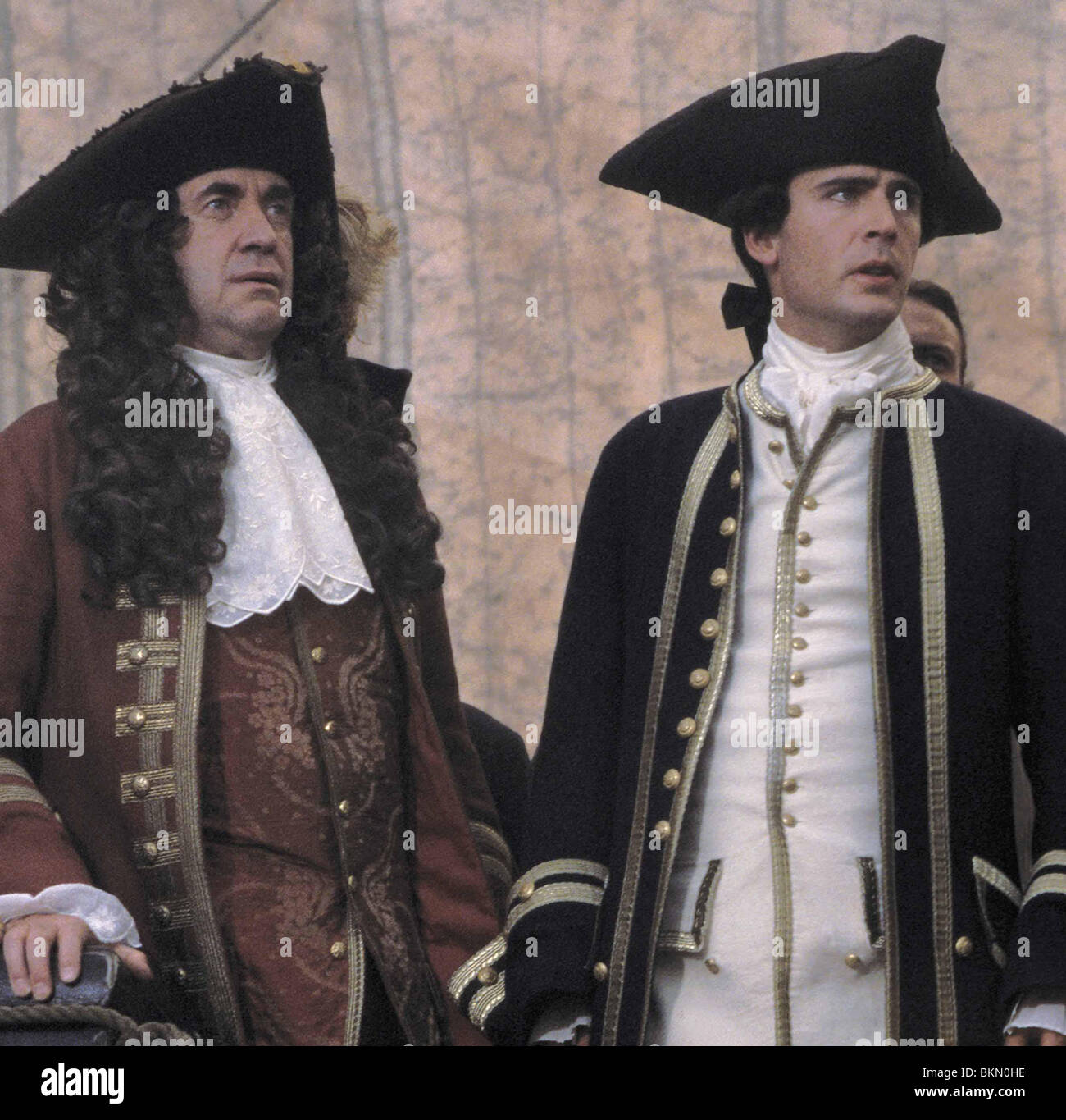 PIRATES OF THE CARIBBEAN: THE CURSE OF THE BLACK PEARL (2003) JONATHAN PRYCE, JACK DAVENPORT CREDIT DISNEY PIRC - Stock Image