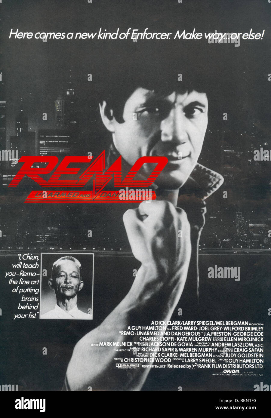 REMO: UNARMED AND DANGEROUS (1985) POSTER REM 001PP - Stock Image