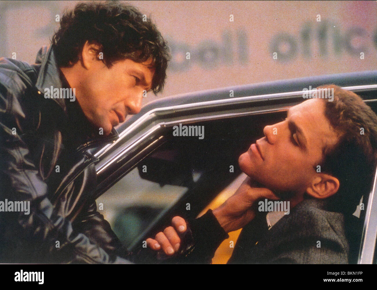 REMO: UNARMED AND DANGEROUS (1985) FRED WARD REM 008FOH - Stock Image