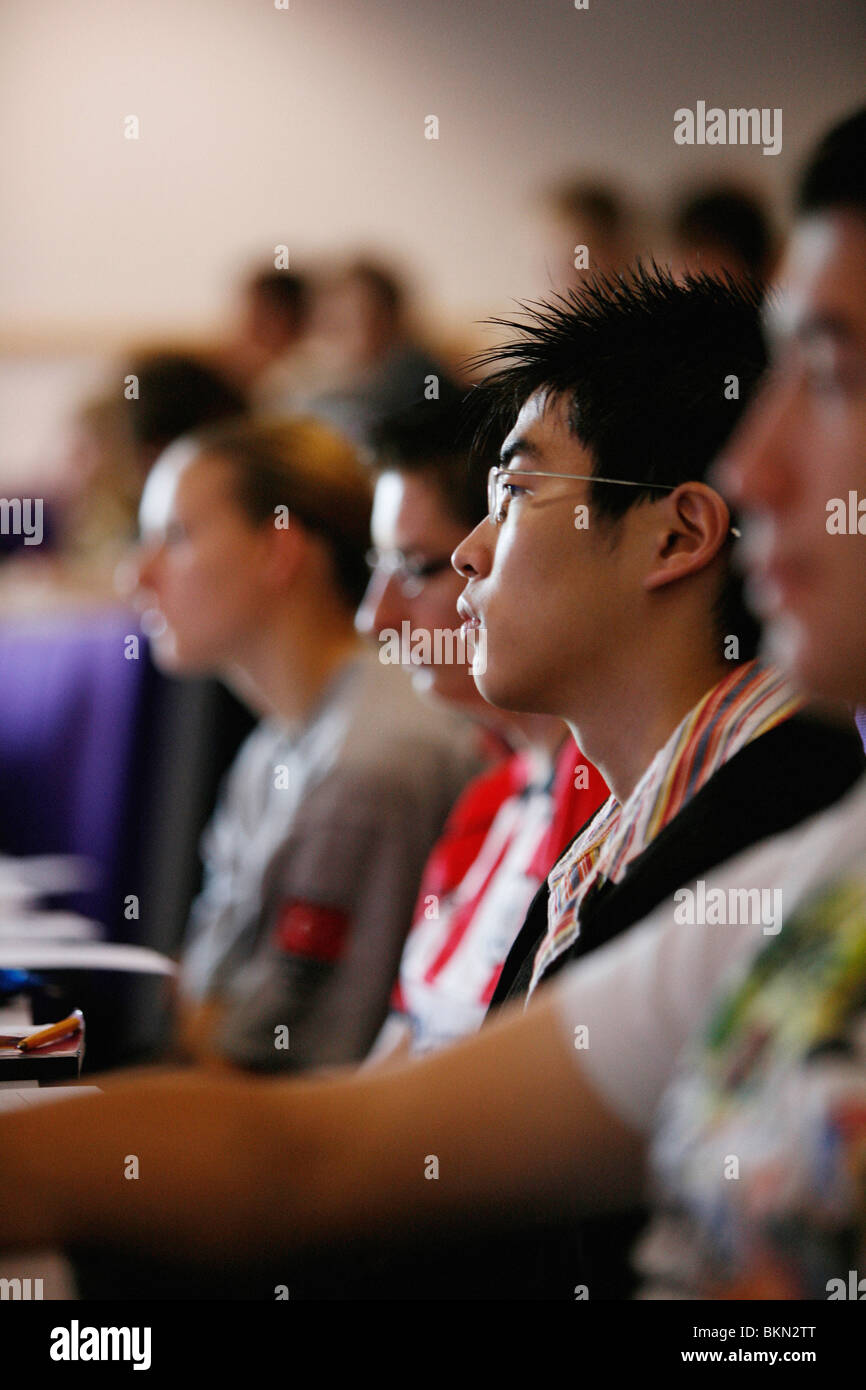 Male university students in a lecture theatre at university - Stock Image