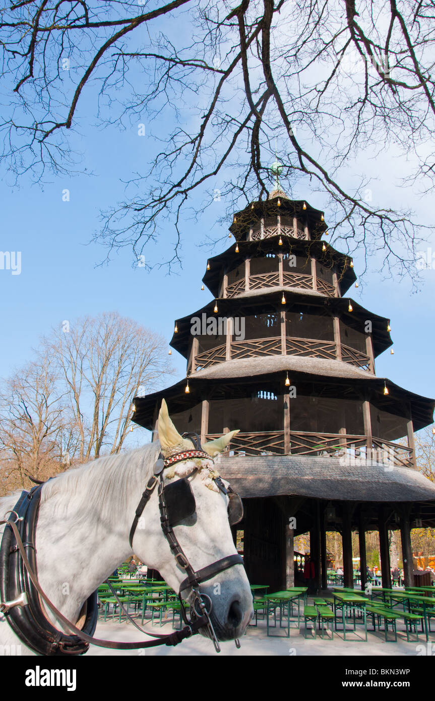 Horse in front of Chinesischer Turm in the 'Englischer garten ' in Munich, Germany. - Stock Image