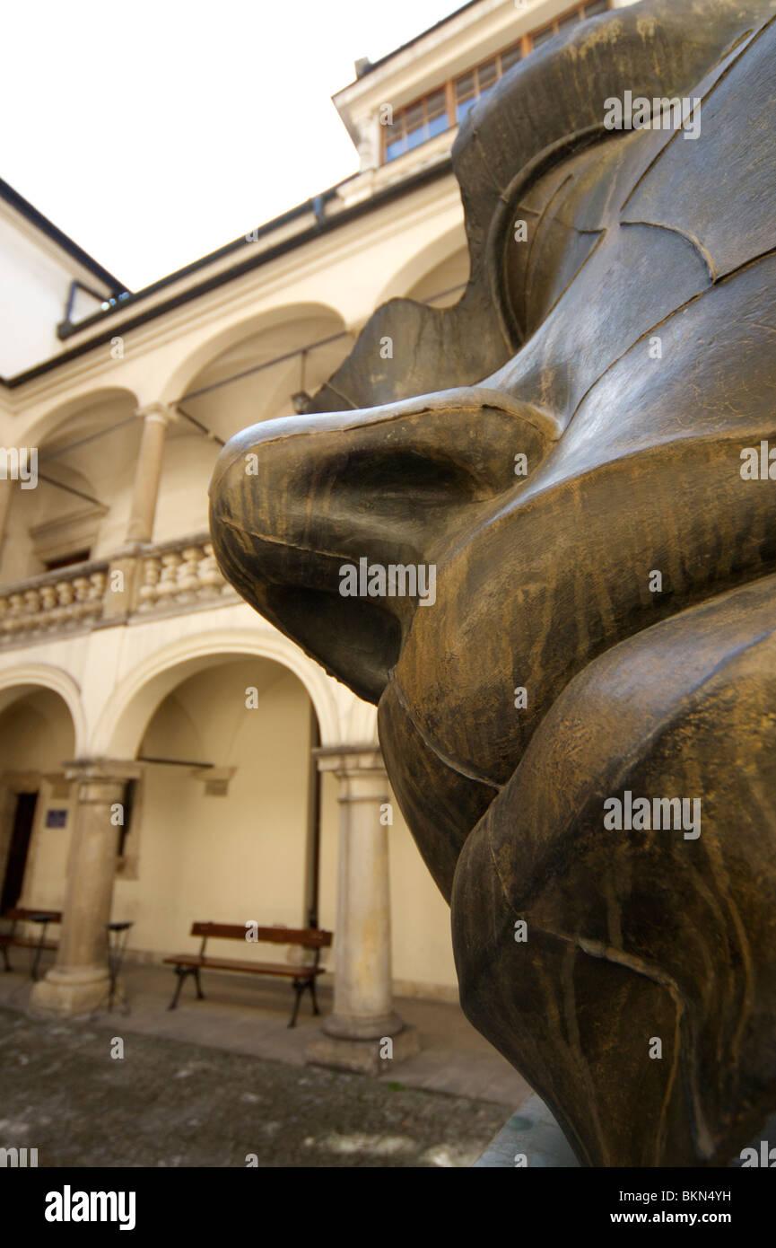 'Luci di Nara' bronze sculpture by Igor Mitoraj located in the courtyard of the Collegium Luridicum in Krakow, Poland Stock Photo