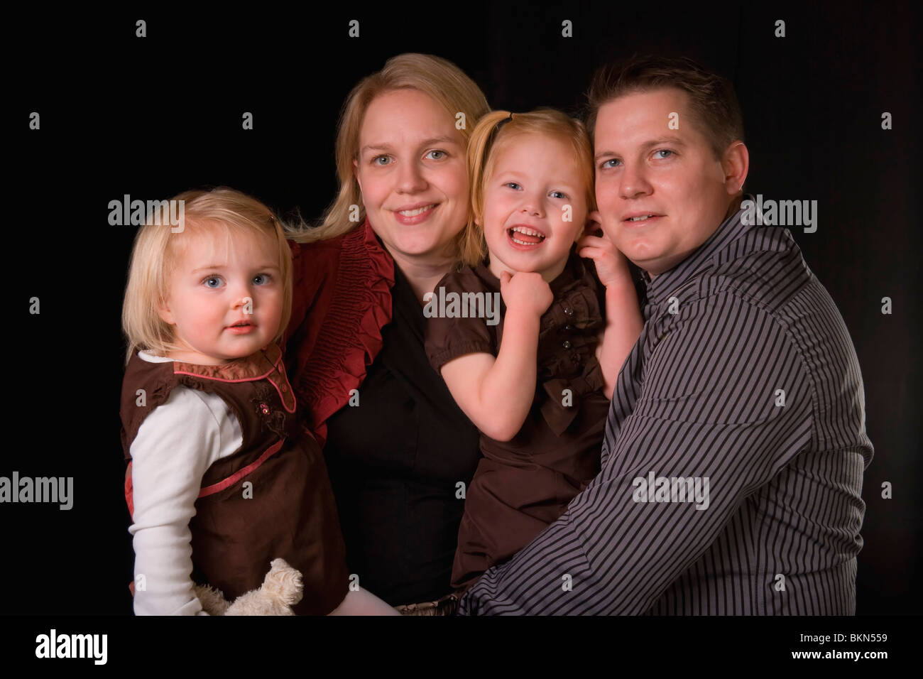 A Mother, Father And Two Daughters - Stock Image