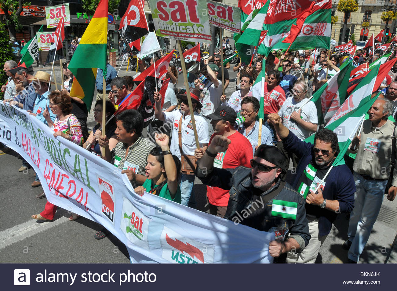 May Day march in Granada, Spain. The March, a traditional world wide event, is held every first of May to celebrate - Stock Image