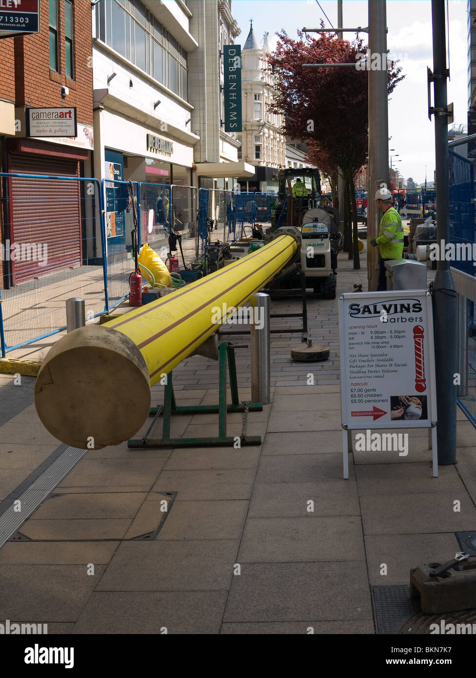 Contractors installing a plastic pipe for a gas main in Middlesbrough town centre - Stock Image