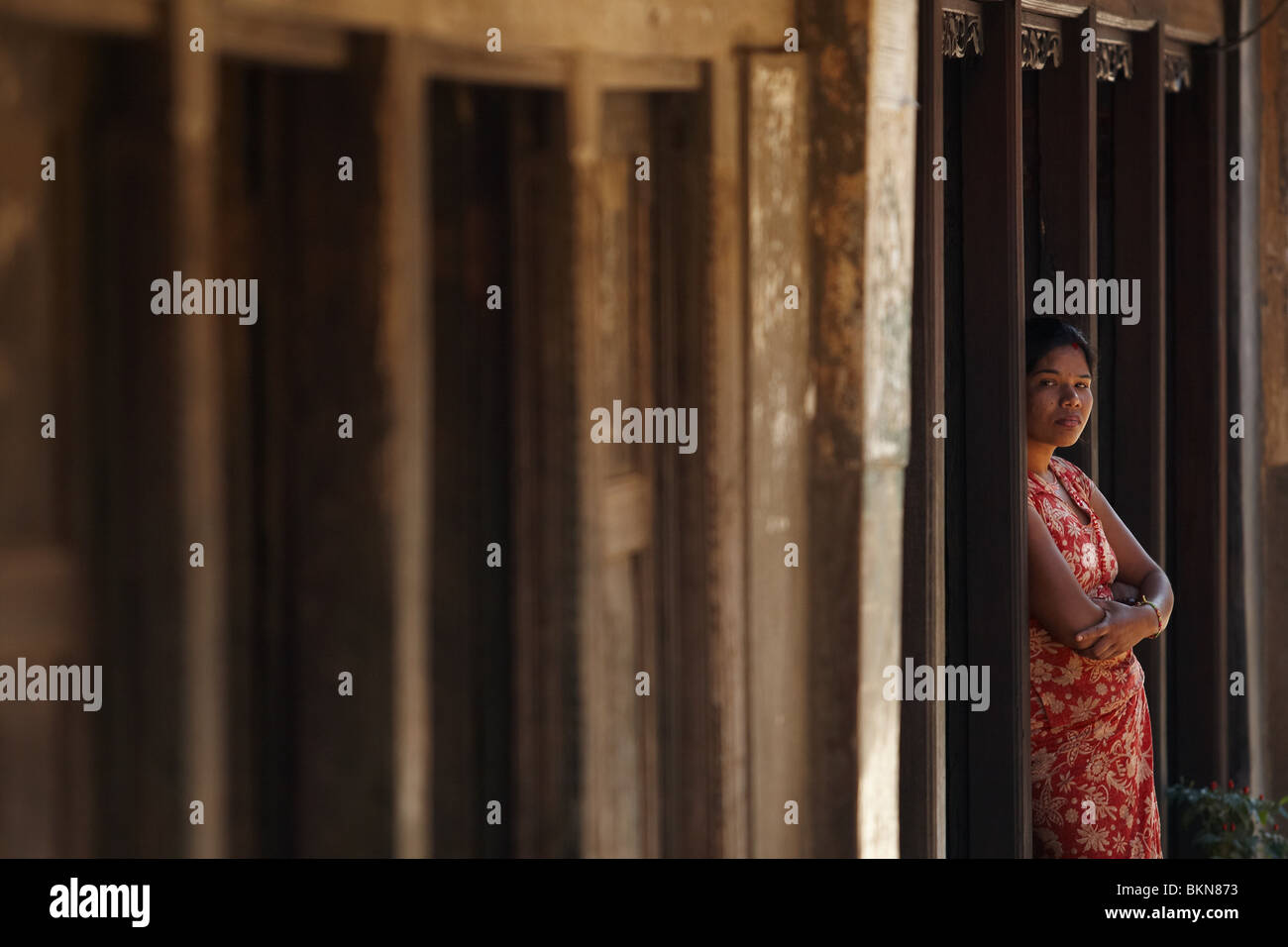 A woman stands in the doorway of her home in Bandipur, Nepal on Thursday October 29, 2009. - Stock Image