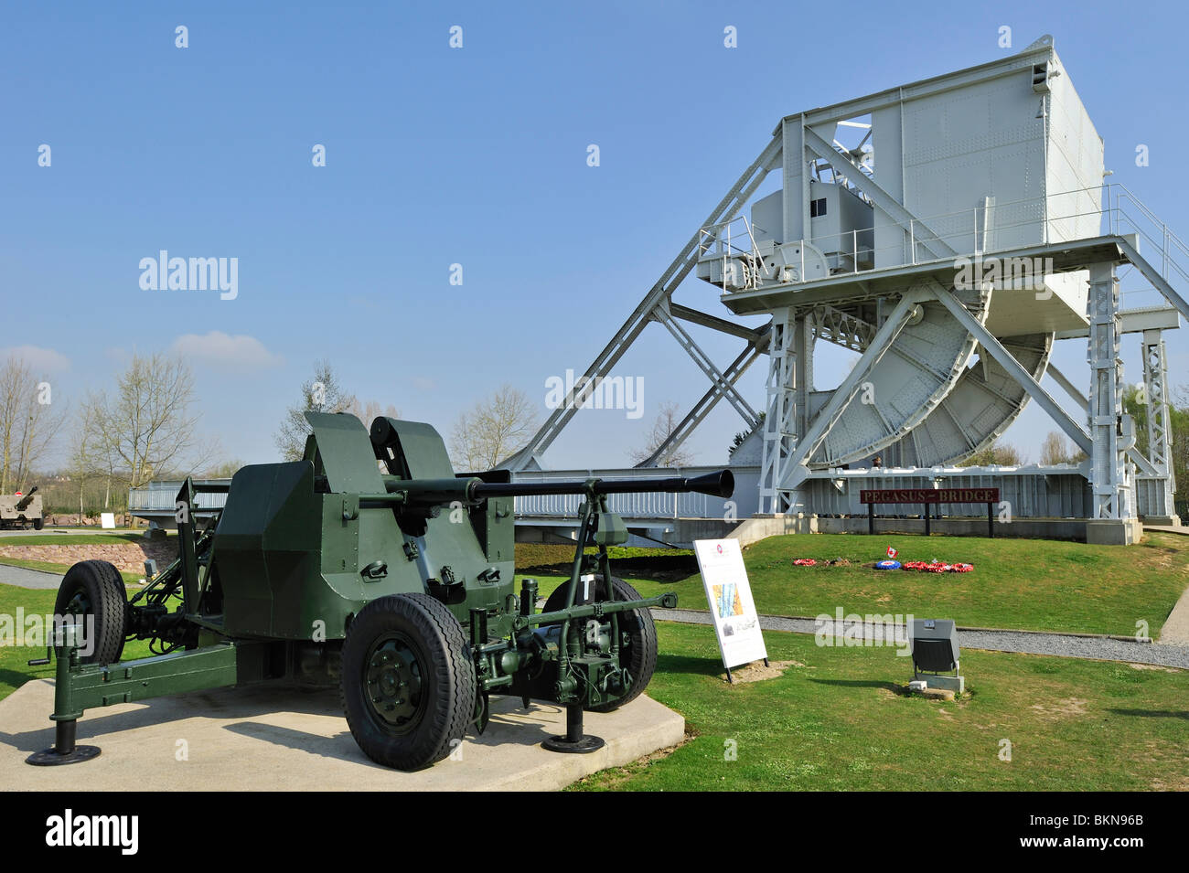 WW2 cannon and original Bénouville Bridge at the Pegasus Museum near Ouistreham, Normandy, France - Stock Image