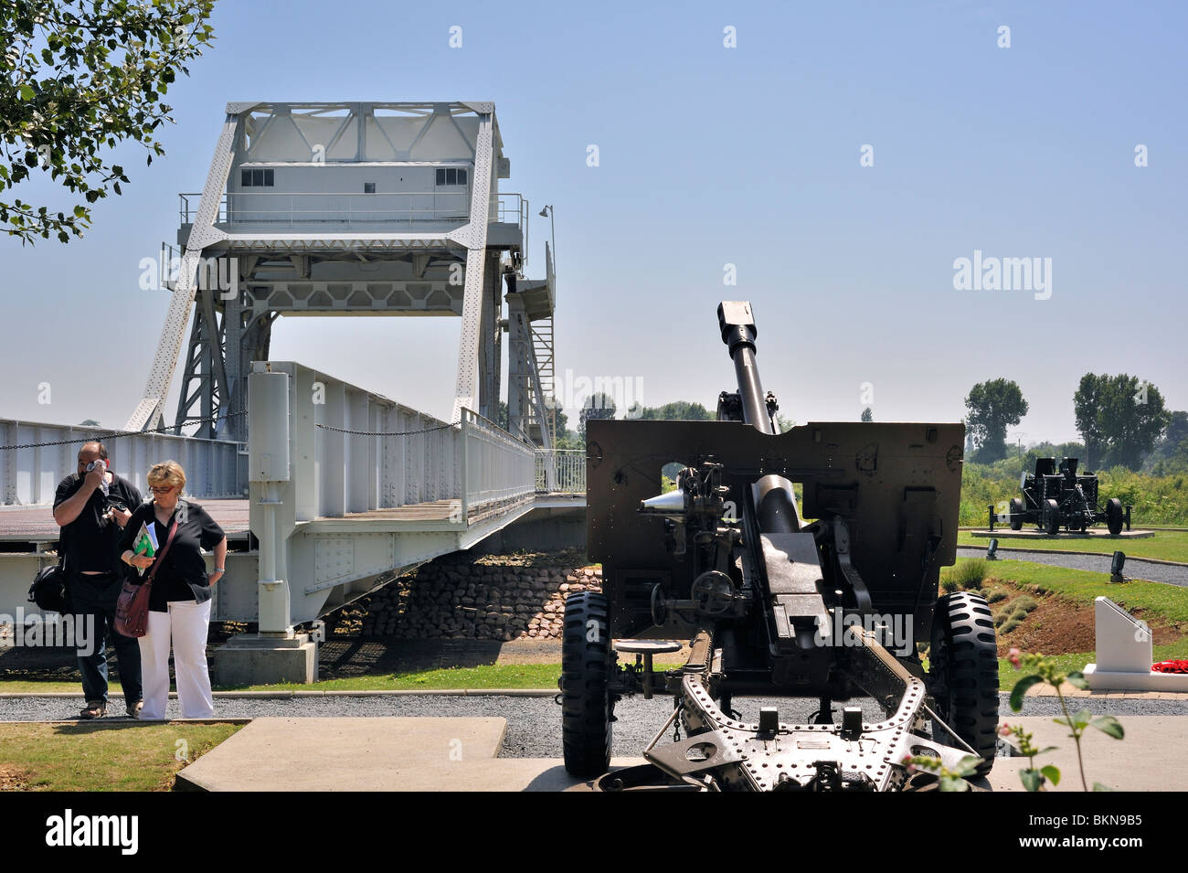 World war Two cannon and original Bénouville Bridge at the WW2 Pegasus Museum near Ouistreham, Normandy, France - Stock Image