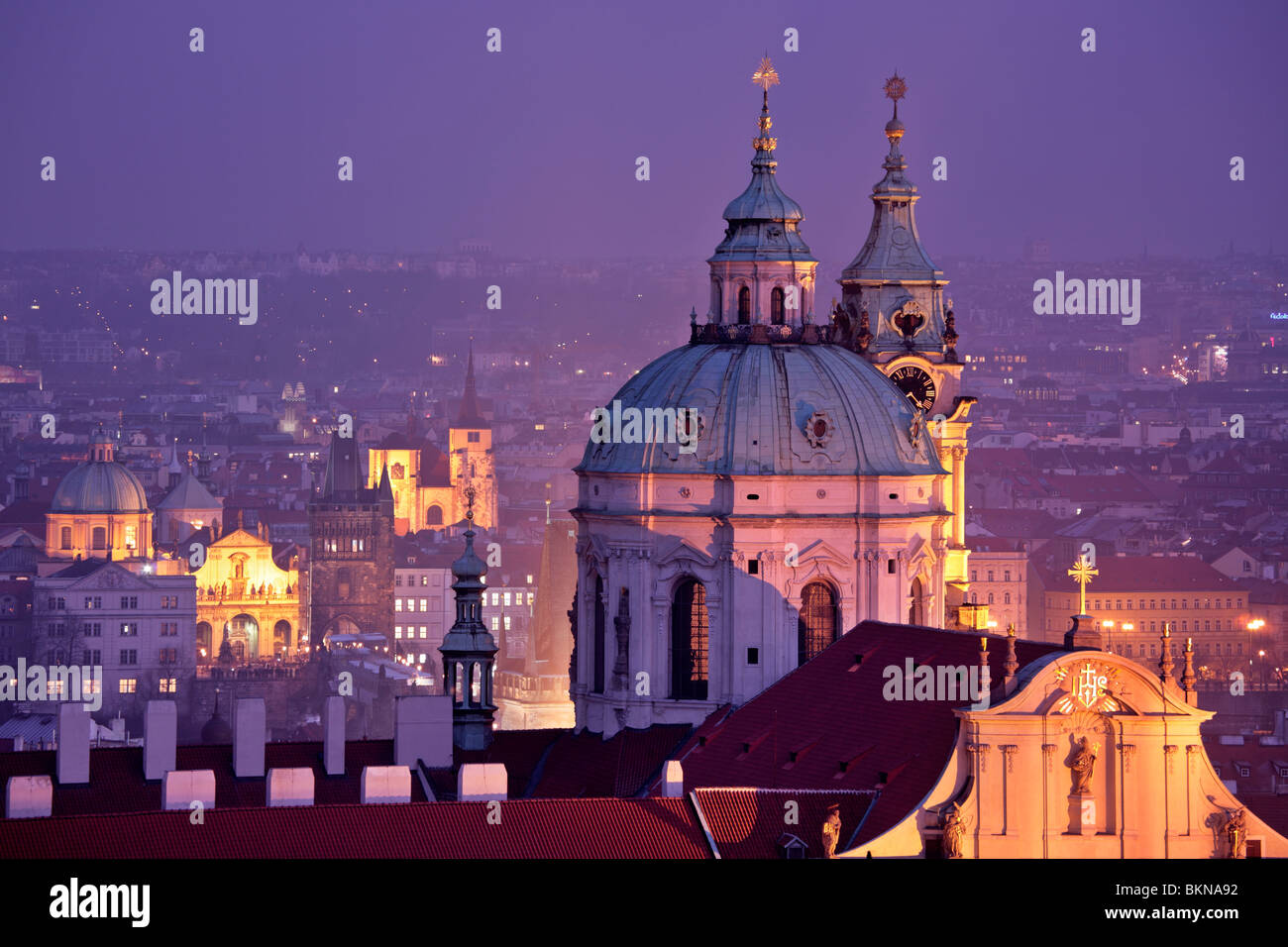 Twilight over St Nicholas Cathedral in Prague - Stock Image
