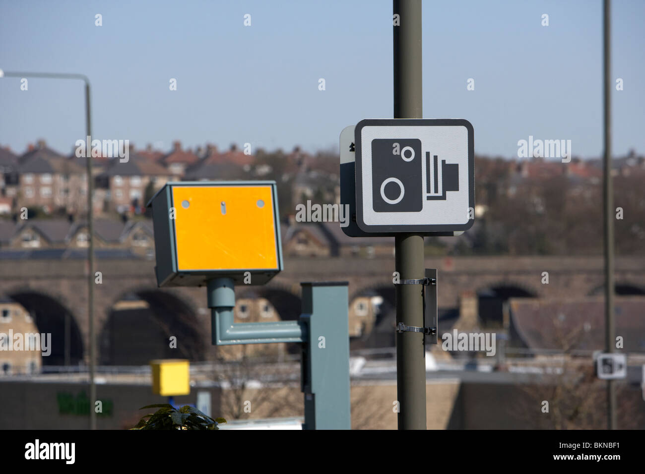 yellow speed traffic cameras and warning signs on a road in Buxton Derbyshire England UK - Stock Image