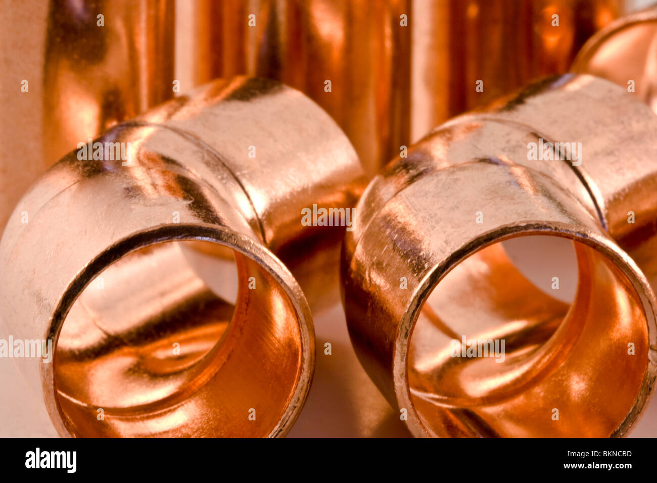 Closeup image of copper fittings used in the plumbing trade - Stock Image