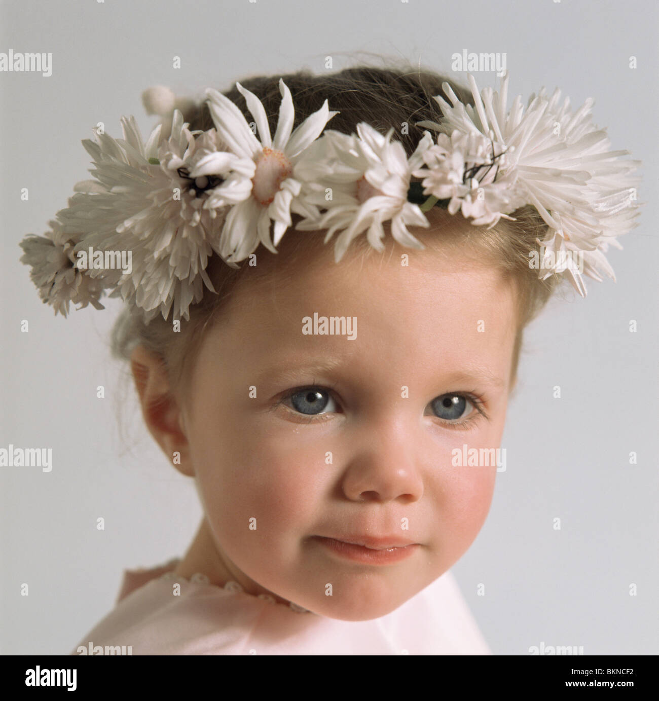 Cloes Up Of A Young Girl Wearing A Crown Made Of Flowers Stock Photo