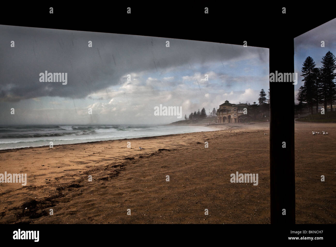 Rain pouring down at the beach, with visible streaks of rain. - Stock Image
