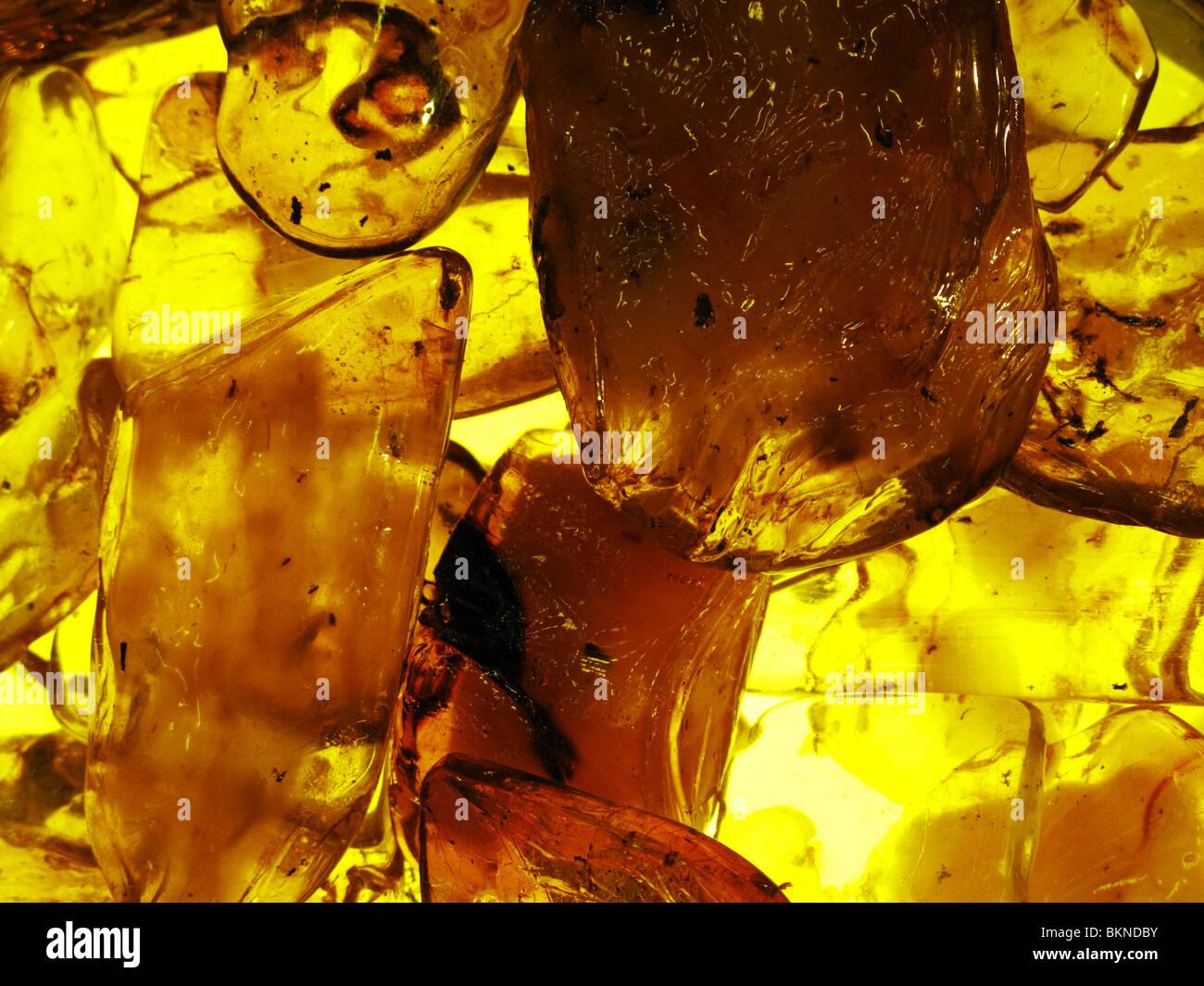 Close up of polished amber stones (fossilized tree resin) - Stock Image