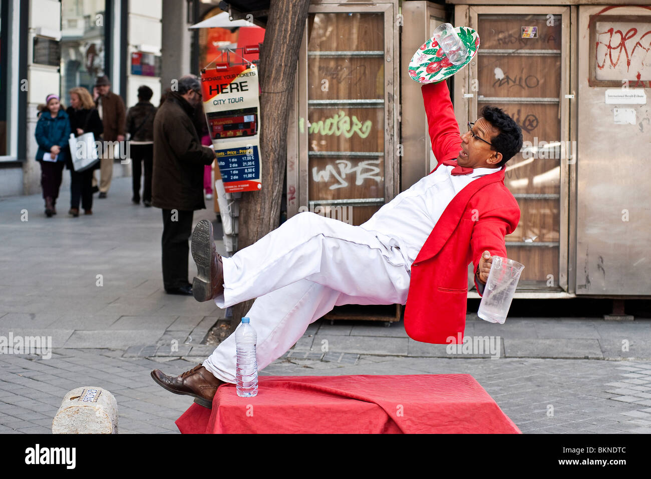 Waiter falling street performer, Madrid, Spain - Stock Image