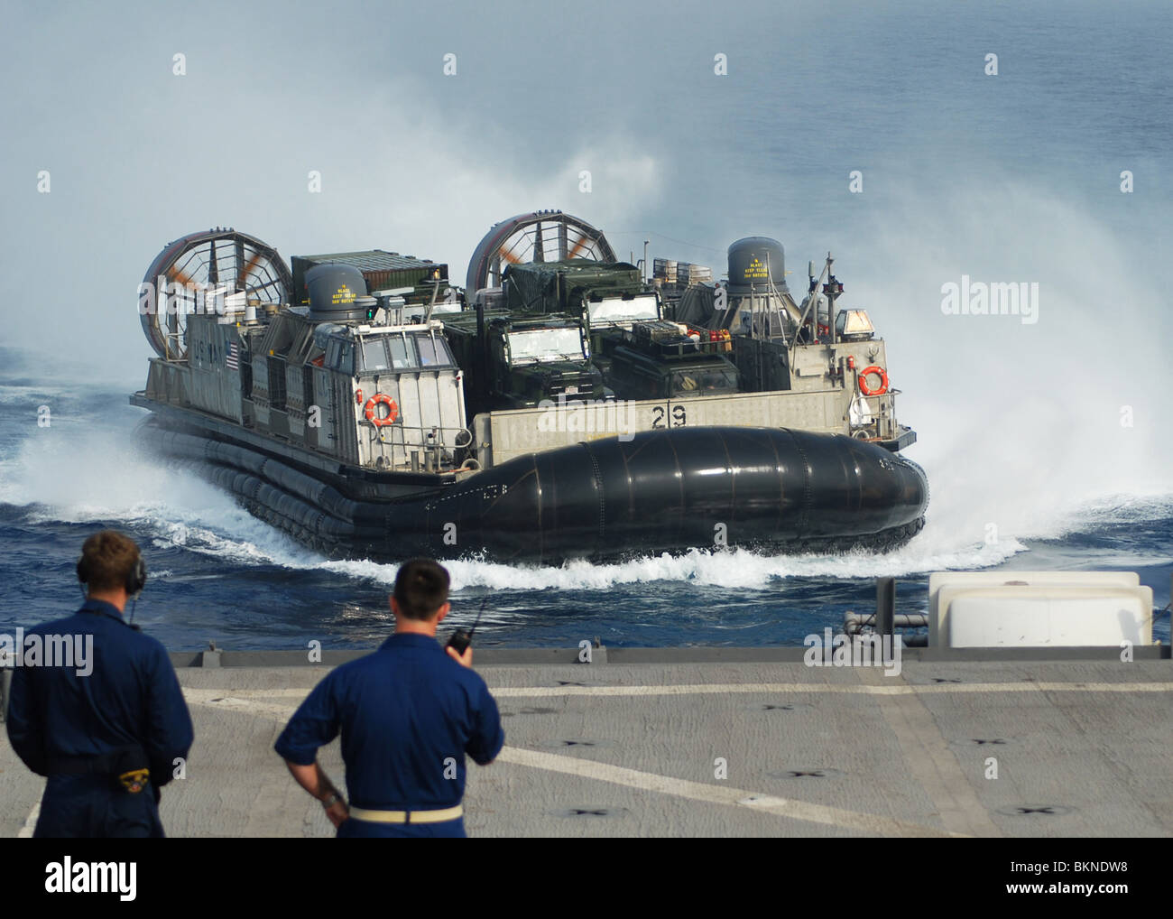 SEA OF JAPAN Sailors observe the Landing Craft Air Cushion (LCAC) 29 assigned to Assault Craft Unit (ACU) 5 - Stock Image