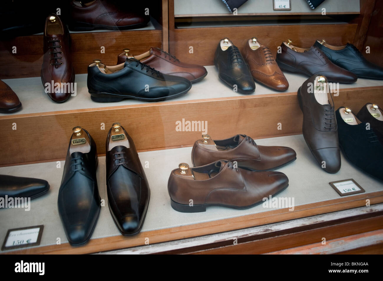 Men's Dress Shoes on Display in Shoe Store Window, Paris, France - Stock Image