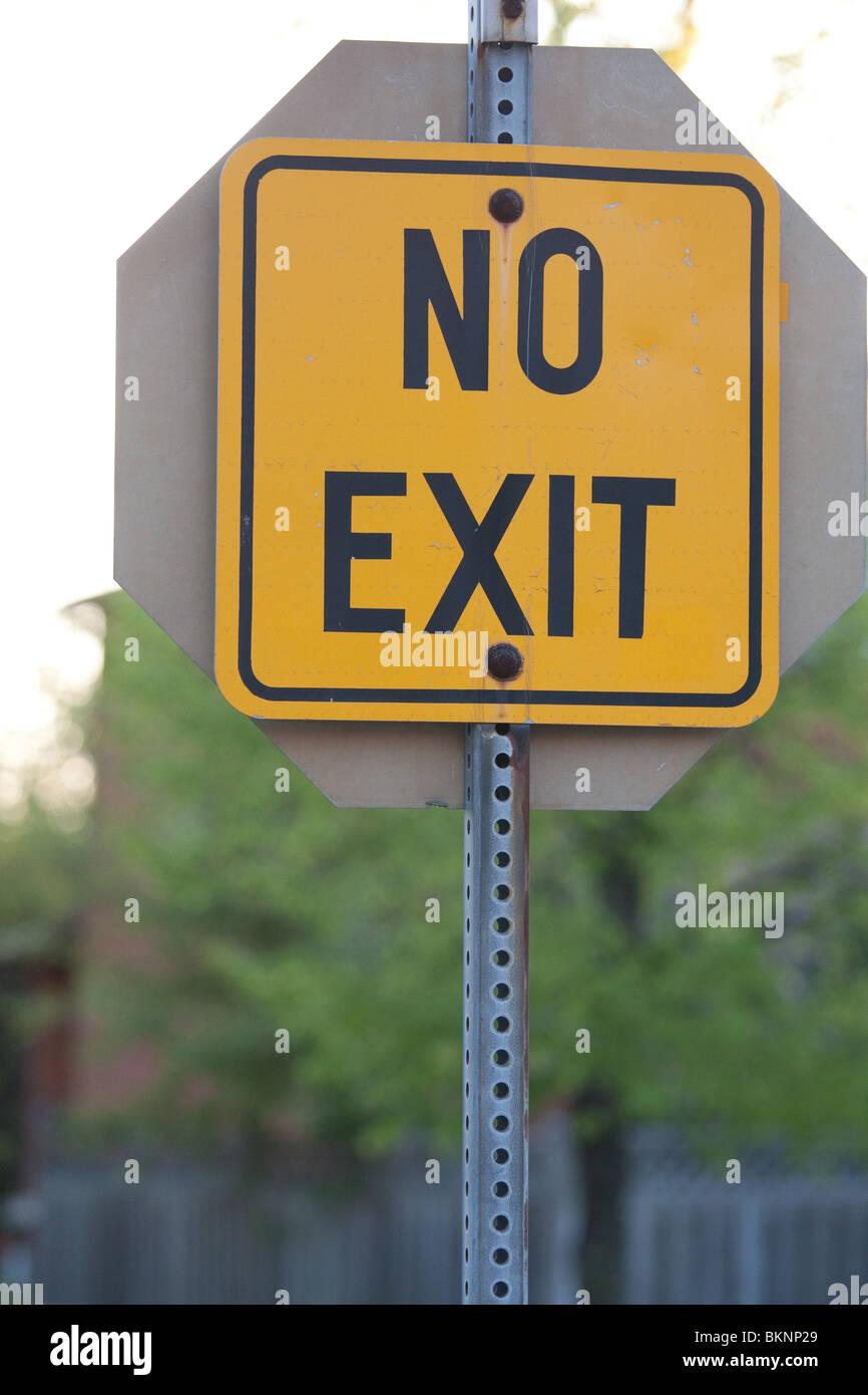 orange no exit sign road street overcast - Stock Image