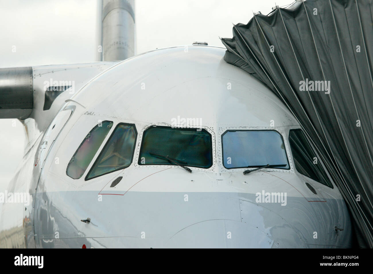 Frontal view of an AVRO passenger plane ready to receive passengers with the covered gangway attached to the aircraft - Stock Image