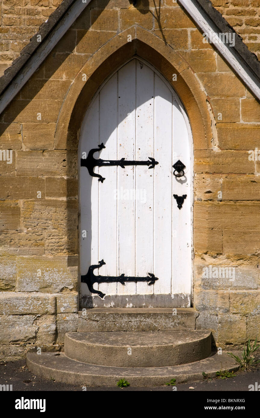 A White Church Door With Black Metal Strap Hinges At Glympton In West  Oxfordshire.