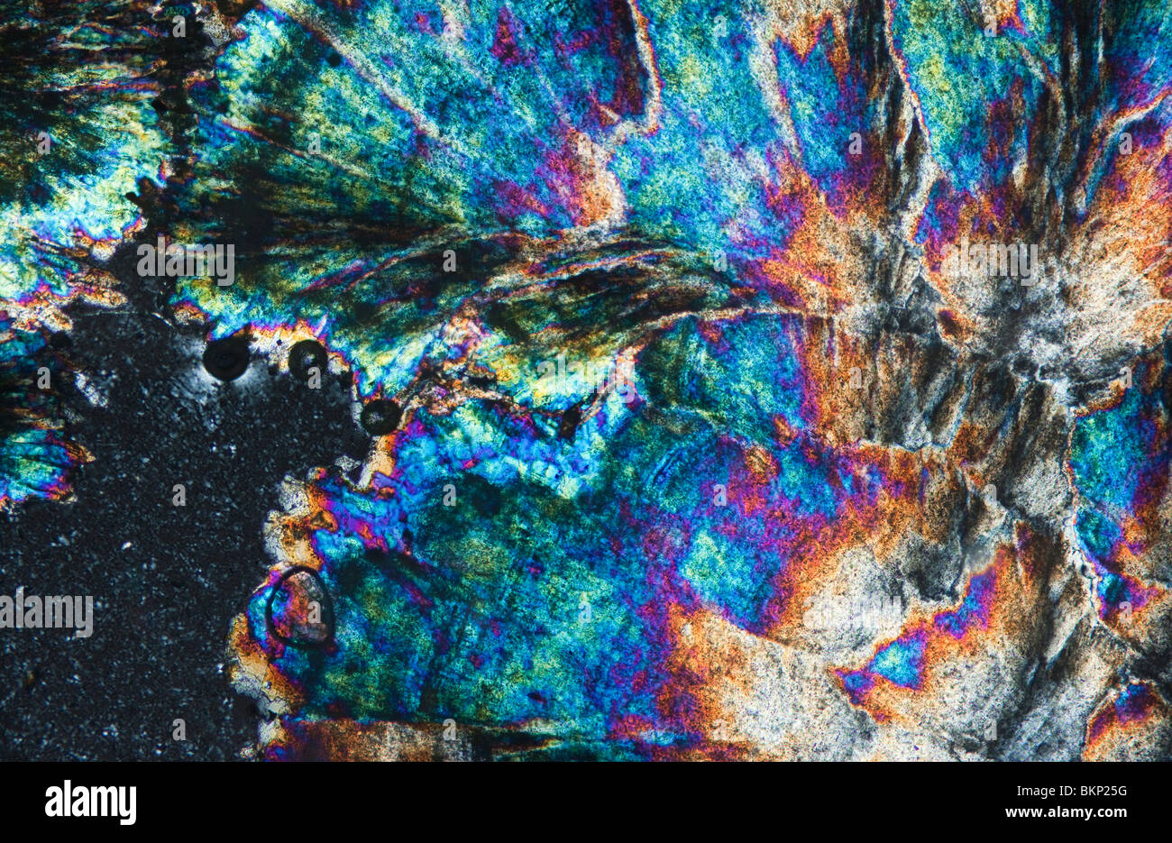 Barytes crystals photographed under a polarising microscope - Stock Image