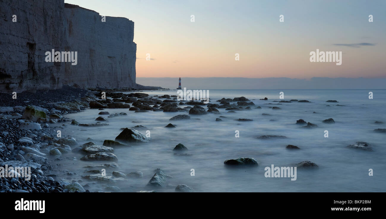Long exposure photograph of the Sussex Coast with Beachy Head lighthouse in the distance - Stock Image