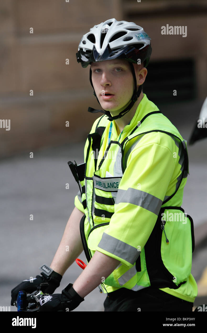 A cycling paramedic misleadingly labeled 'ambulance' during Nottingham's Mayday Rally which took place on Saturday, Stock Photo