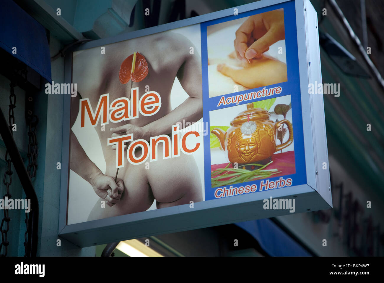 Chinese herbs acupuncture male tonic sign, Wardour Street, Soho, London, England - Stock Image