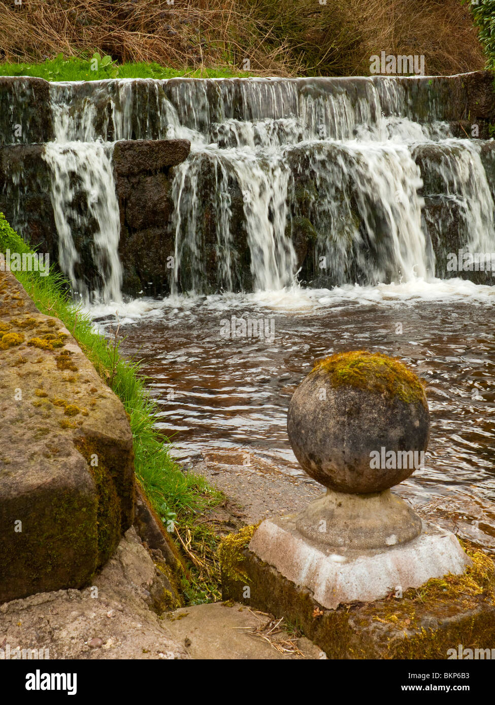 Weir on the River Churnet in the village of Upper Hulme near Leek in the Peak District National Park Staffordshire - Stock Image