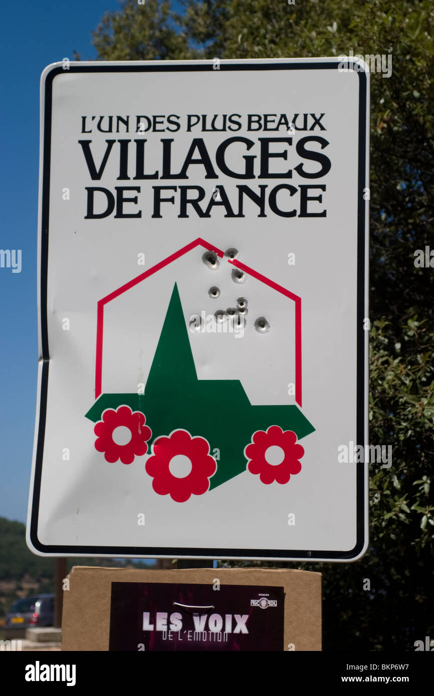 French Government Tourist sign with bullet holes, Corsica Stock Photo