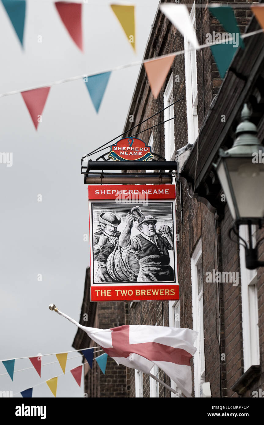 A Sheperd Neame pub sign on the wall of a building.  Photo by Gordon Scammell - Stock Image