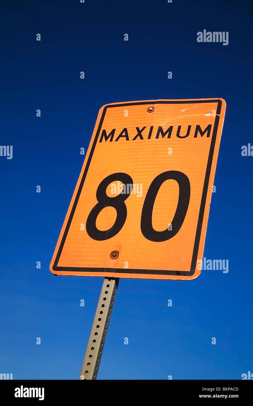 Orange 80 Maximum Speed Limit Traffic Sign Against A Blue Sky Background - Stock Image