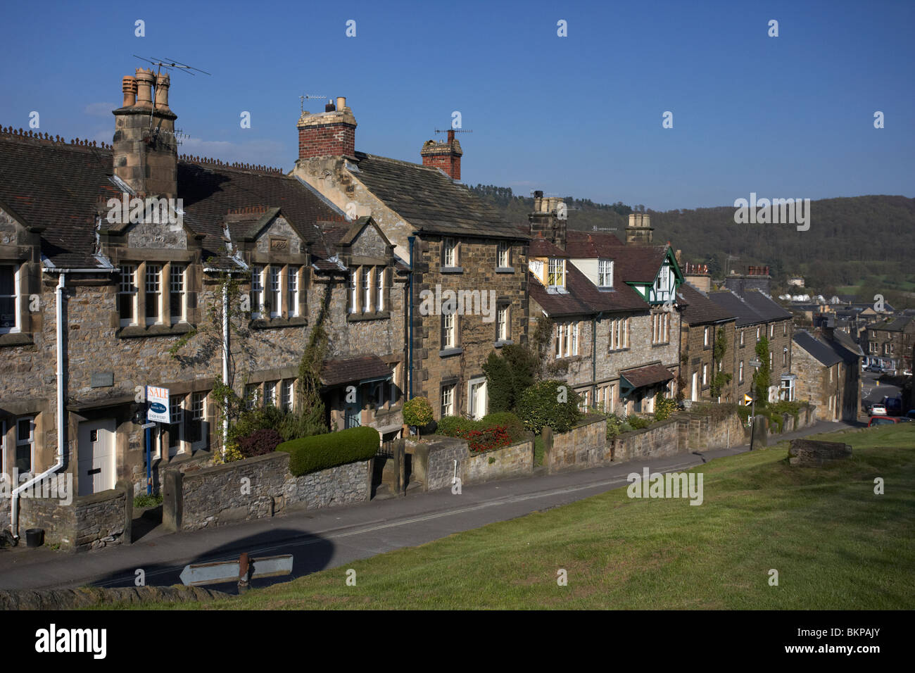 terraced houses on the hill in church street Bakewell market town in the high Peak District Derbyshire England UK - Stock Image