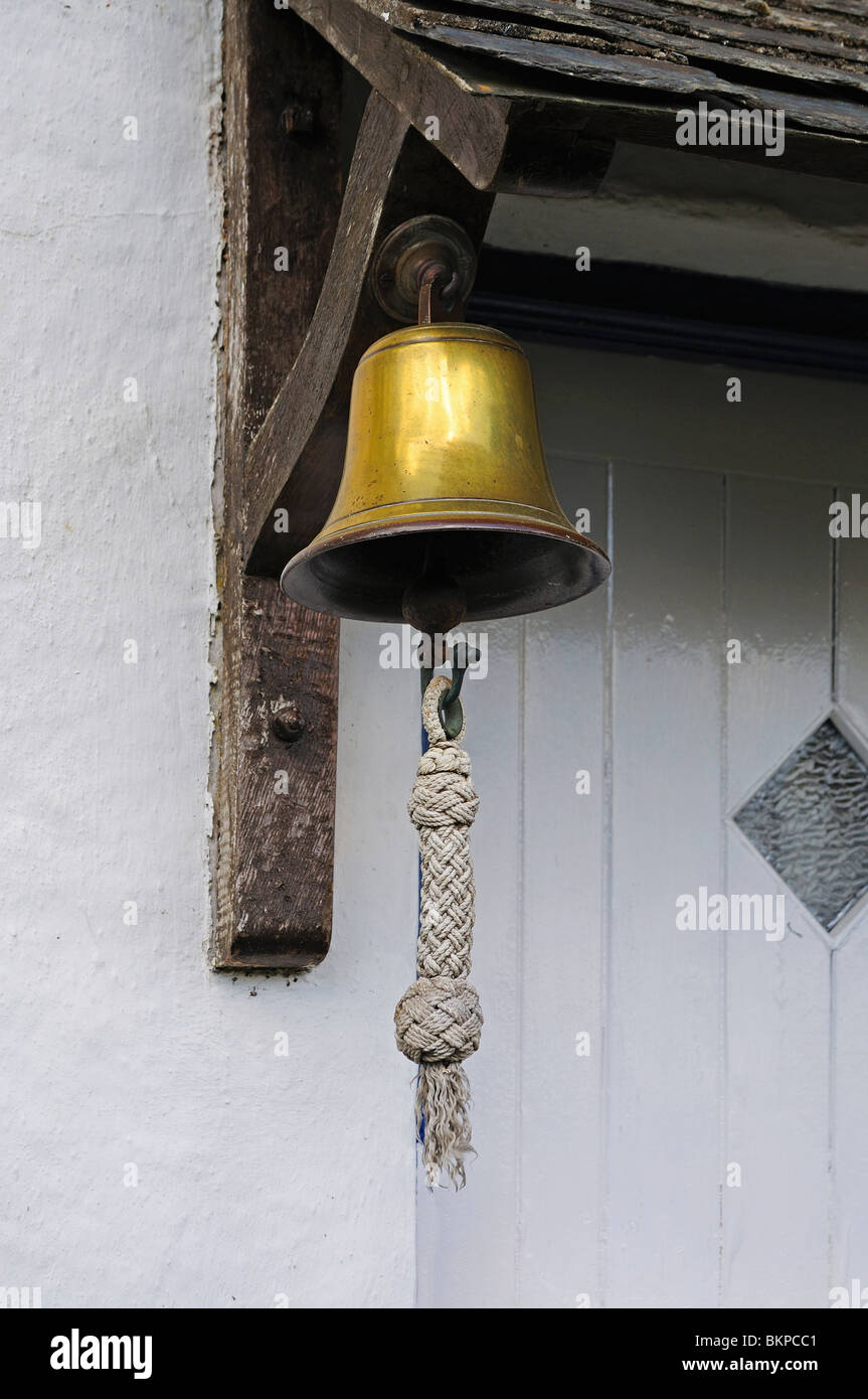 a brass bell doorbell on a cottage in somerset, uk - Stock Image