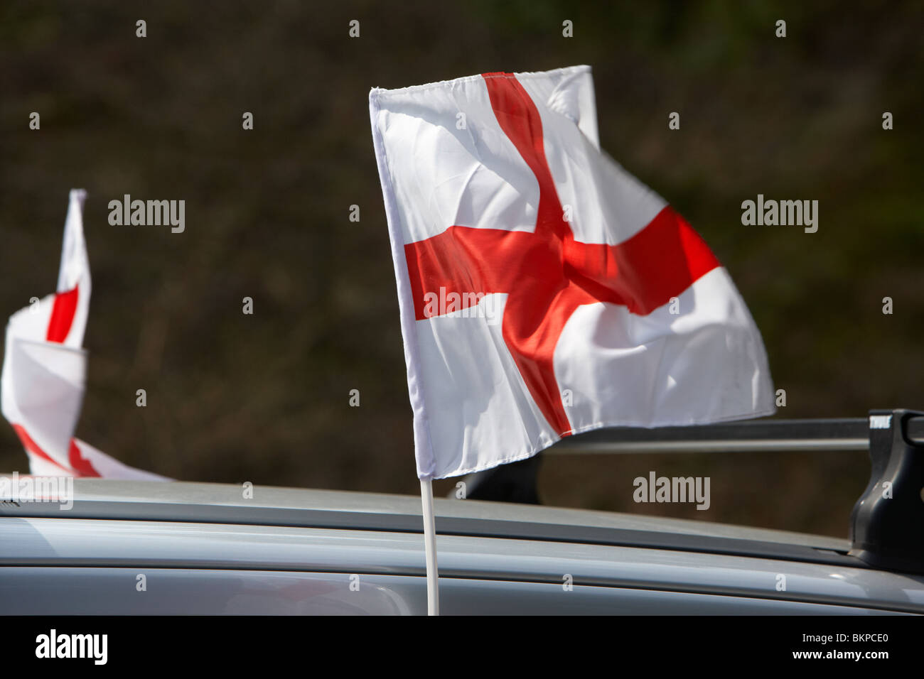 mini cross of St George english national flag flying on a car on st georges day england uk Stock Photo