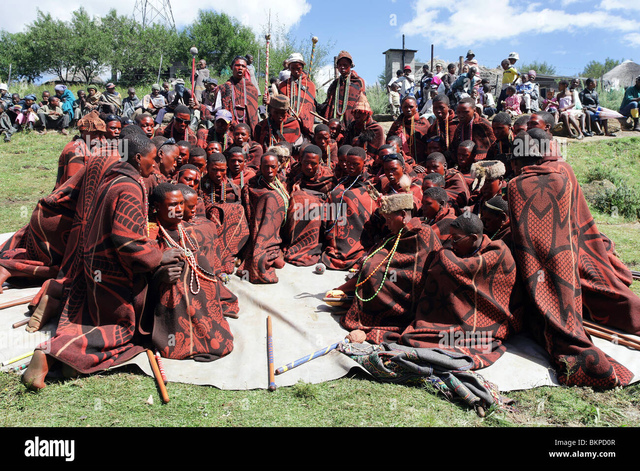 Lesotho: Redly made up young men celebrate an initiation celebration their admission into the world of adult men. - Stock Image