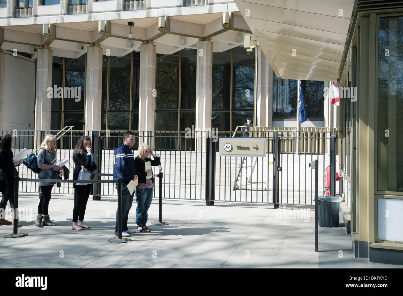 British teenagers waiting at the US embassy to apply for visas, The US Embassy, Grosvenor Square, London UK - Stock Image