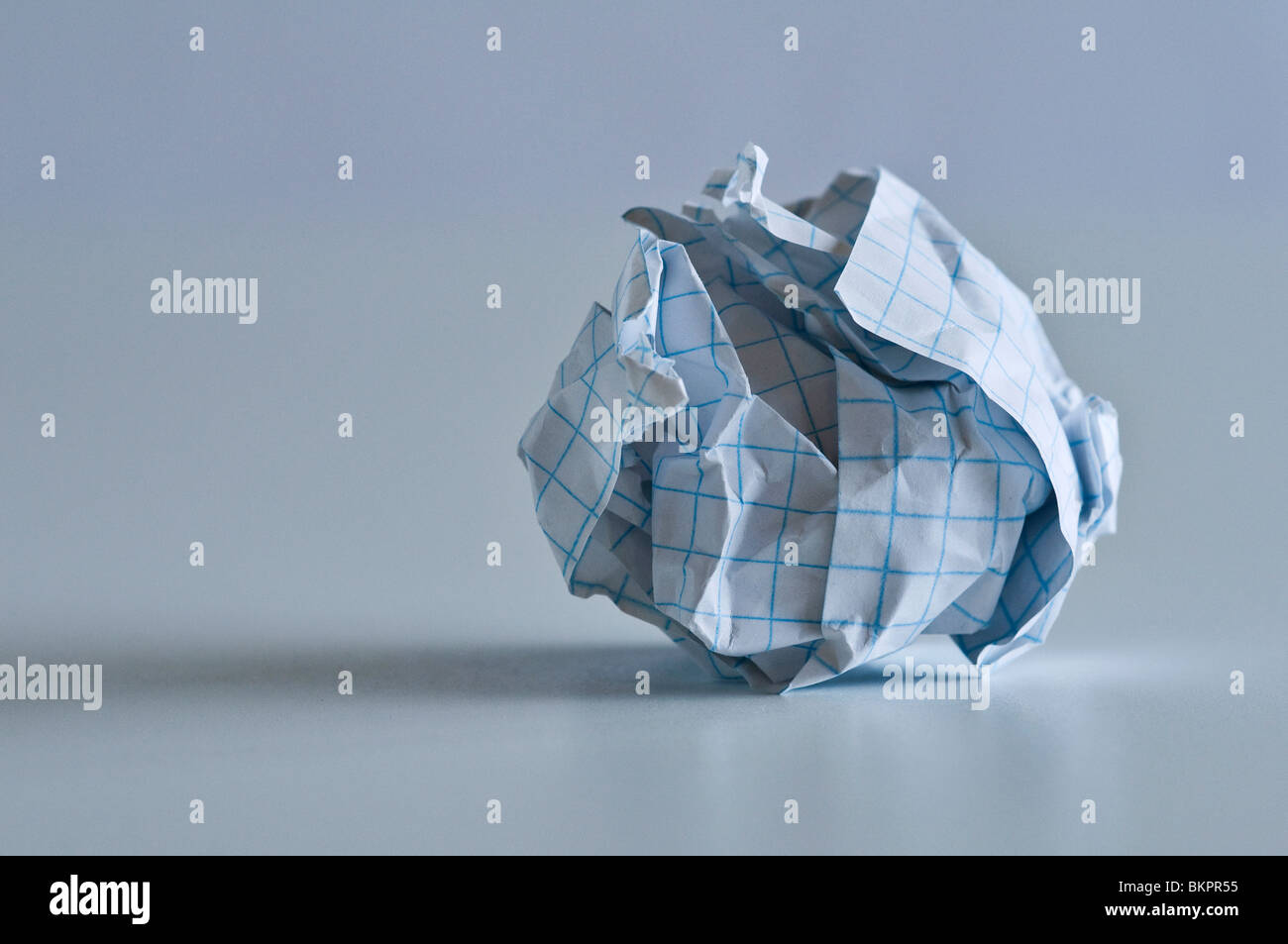 Crumpled ball of grid paper. - Stock Image